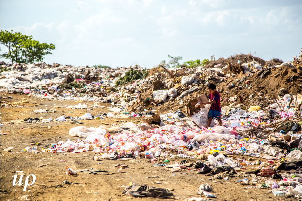 Urban centres generate huge bulks of waste, management of which is a global concern. The lives of those tackling with this menace are often overlooked in front of magnitude of the dumps. Seen here is a boy managing trash in an urban region of central African country of Nicaragua.