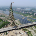 Seen here is a view of under-construction Signature Bridge. It lies downstream of Wazirabad barrage and is the latest bridge, over river Yamuna in Delhi, to be opened for public use.